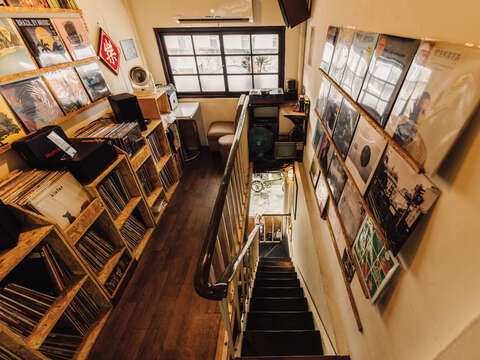 Hidden in a small attic, visitors can enjoy a record hunt in THT Records' cozy space, along with its inviting cafe area.
